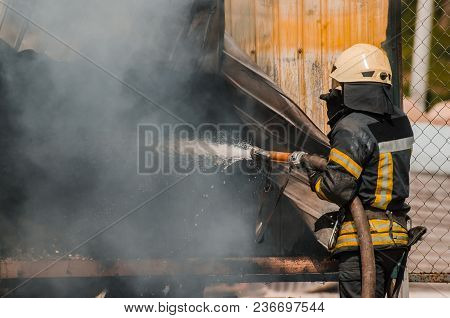 Fireman Extinguishes Fire.the Concept Of Saving People In A Fire