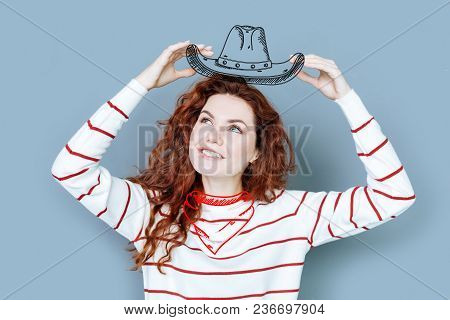 Cowboy Costume. Young Cheerful Woman Pretending To Be A Cowboy While Enjoying A Funny Costume Party