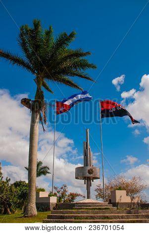 Santa Clara, Cuba: Monument of the Lomo del Capiro in Santa Clara. Attraction on the hill of the city. Developing the flag of Cuba poster
