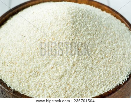 Semolina In A Wooden Bowl On A Light Background