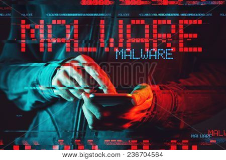 Malware Concept With Male Person Using Smartphone, Low Key Red And Blue Lit Image And Digital Glitch
