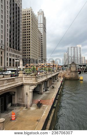 Chicago, Usa - June 26, 2013: People Walk Downtown In Chicago. Chicago Is The 3rd Most Populous Us C