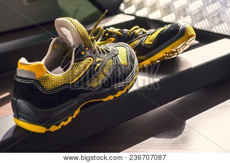 Unbranded Modern Sneaker In The Gym. Black-yellow. Comfortable Shoes. Wearing Sport Shoes, Doing Wid