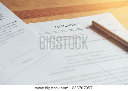 Closeup Of Signing A Documentation Agreement And Pen On The Table.