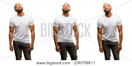 African american man with beard with sleepy expression, being overworked and tired