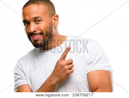 African american man with beard pointing away side with finger isolated over white background