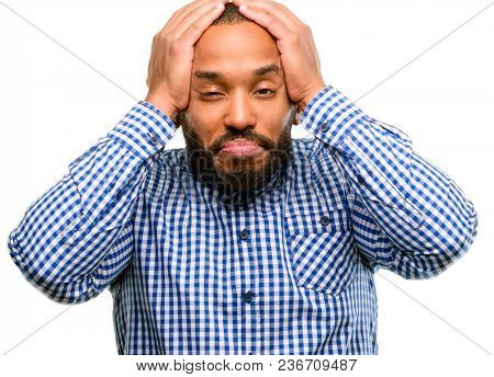 African american man with beard covering ears ignoring annoying loud noise, plugs ears to avoid hearing sound. Noisy music is a problem. isolated over white background