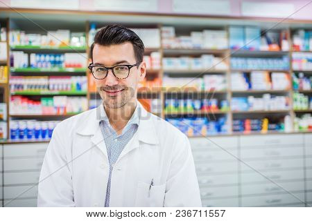 Portrait Of A Young Atrractive Friendly Male Pharmacist.