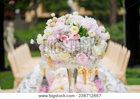 Wedding Decoration With Flowers On A Table Outdoors