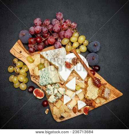 Camembert Cheese With Honey, Figs, Walnuts On Wooden Cutting Board