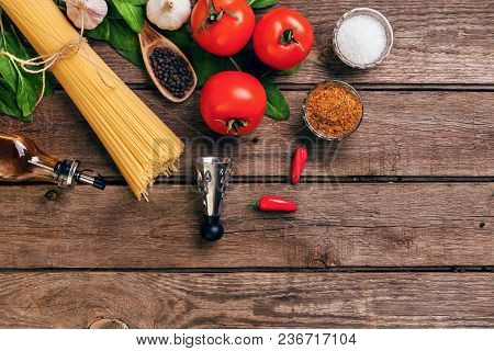 Pasta And Ingredients On Wooden Background With Copy Space. Top View. Vegetarian Food, Healthy Or Co