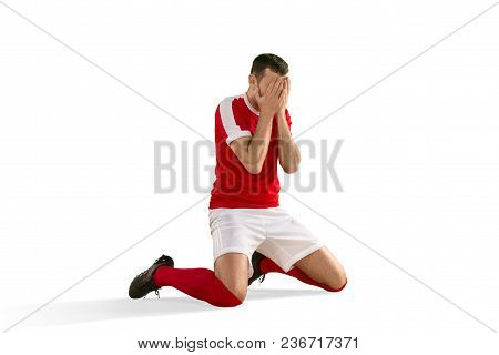 The Male Unhappy Soccer Or Football Player With Palm On His Face After Goal. The Professional Soccer