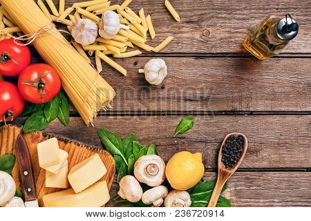 Ingredients For Spaghetti With Basil, Tomatoes, Cheese On Wooden Background, Top View, Place For Tex