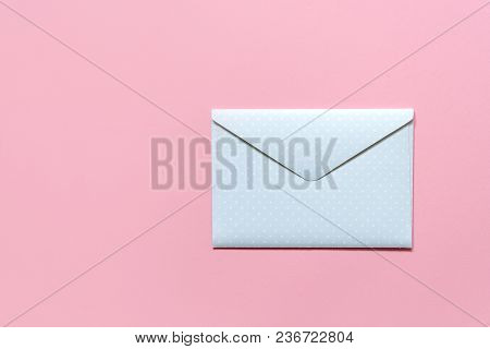 Blue Envelope In White Peas On A Pink Background