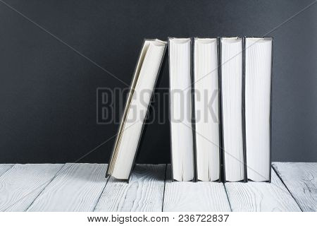 Open Book, Hardback Black, White Books On Wooden Table. Back To School. Copy Space For Text. Educati