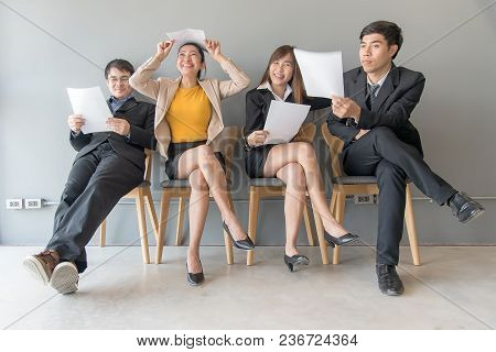 Job Interview. Group Of Asian People Review Document While Waiting For Job Interview. Business Conce