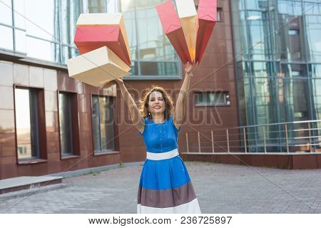 Happiness, Consumerism, Sale And People Concept - Woman With Shopping Bags.