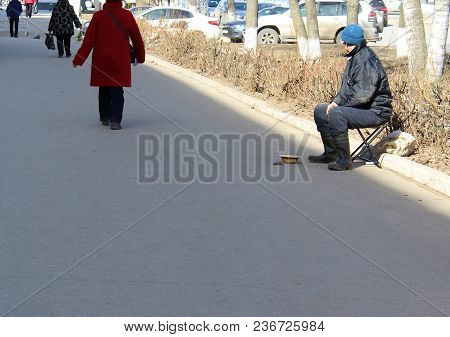 A Person Without A Certain Residence Asks For Money From Passers-by