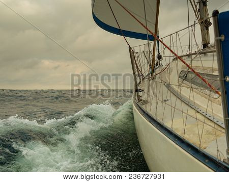 Seascape Before Storm, Dark Clouds On Sky, Sunset Weather. Sailing Boat, Idyllic View.