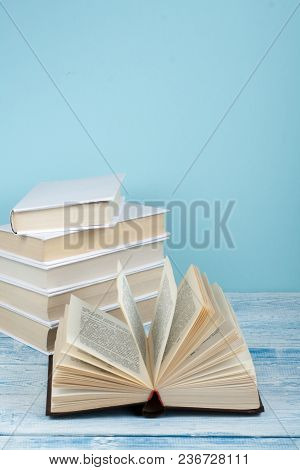 Book Stacking. Open Book, Hardback Books On Wooden Table And Blue Background. Back To School. Copy S