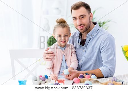 Father And Daughter Celebrating With Easter Eggs