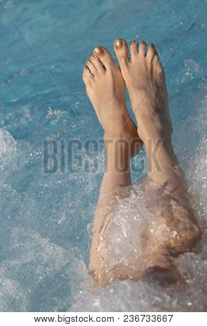 Two Feet During The Hydromassage Session In The Spa Pool