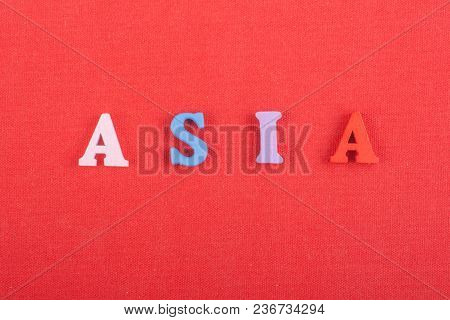 Asia Word On Red Background Composed From Colorful Abc Alphabet Block Wooden Letters, Copy Space For