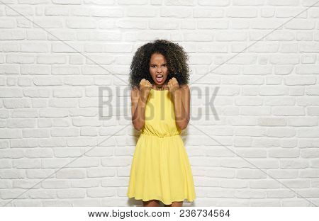 Portrait Of Worried Woman. Black Girl Showing Fear, Terror And Depression. Copy Space