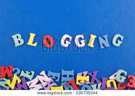 Word On Blue Background Composed From Colorful Abc Alphabet Block Wooden Letters, Copy Space For Ad