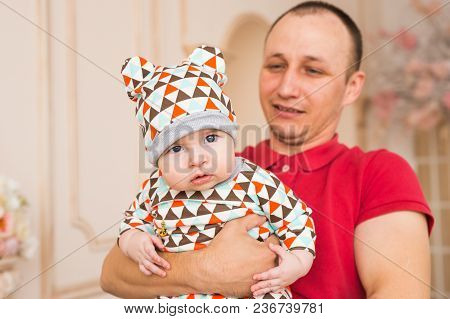 Handsome Man Holding A Baby Son Indoors