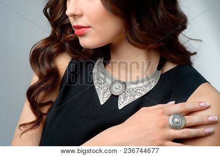 The Beautiful Woman With Silver Necklace On A White.