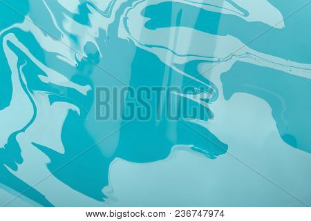 Liquid Marbling Blue Paint Background. Fluid Painting Abstract Texture. Colorful Mix Of Acrylic Vibr
