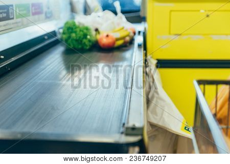 Products On The Cash Desk. Grocery Shopping. Out Of Focus