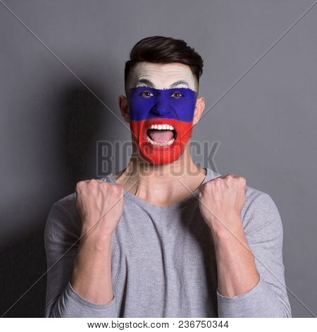 Face Of Young Screaming Man Painted With Flag Of Russia. Football Or Soccer Team Fan, Sport Event, F