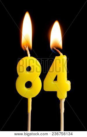 Burning Candles In The Form Of 84 Eighty Four (numbers, Dates) For Cake Isolated On Black Background