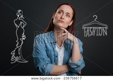 Thoughtful Designer. Clever Young Experienced Designer Thoughtfully Looking Into The Distance While