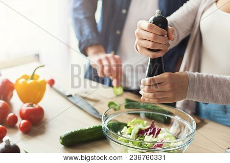Closeup Of Couple Cooking Healthy Food Together In Their Loft Kitchen At Home. Preparing Vegetable S