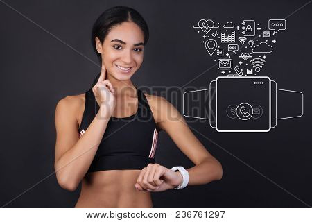 Measuring Pulse. Young Beautiful Sportswoman Touching Her Neck And Looking At The Smart Watch While