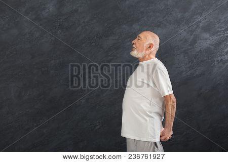 Senior Fitness Man Warmup Training Indoors. Sporty Mature Guy Makes Aerobics Exercise, Stretching Ba