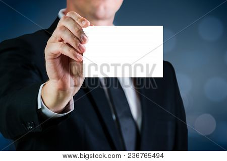 Man Holding A White Business Card With Blank For Advertising. Copy Space Concept