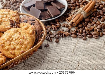 Peanut Cookies And Chocolate Chips Cookies In Wicker Basket On Light Surface And Scattered Coffee Be