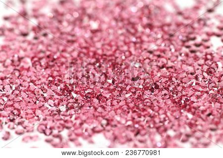 Many Scattered Rhinestones On A White Background