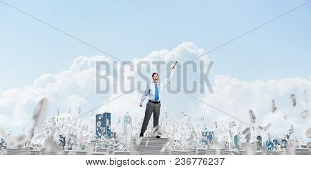 Businessman Keeping Hand With Book Up While Standing Among Flying Letters With Cloudly Sky On Backgr