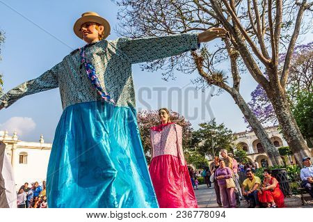 Antigua, Guatemala -  March 9, 2018: Dance Of Traditional Giant Folk Dancing Puppets Called Gigantes