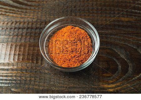 Seasoning In A Glass Jar On A Wooden Background
