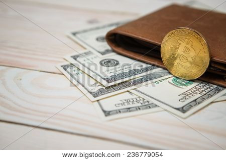 Bitcoins Hundred Dollar Bills And Leather Wallet On Wooden Background