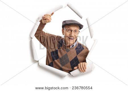 Cheerful elderly man breaking through paper
