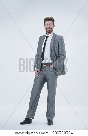 Half length portrait of a businessman with hands in his pockets