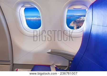 Empty seat at the window of passenger airplane