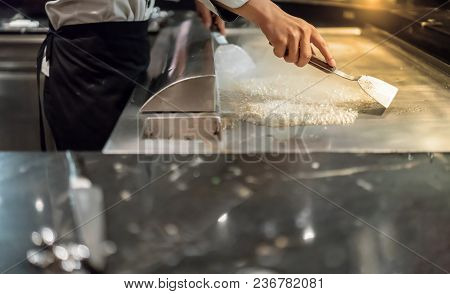 Ice Cubes On Hot Stove. Way To Clean And Maintenance Stainless Steel Stove After Teppanyaki Cooking.